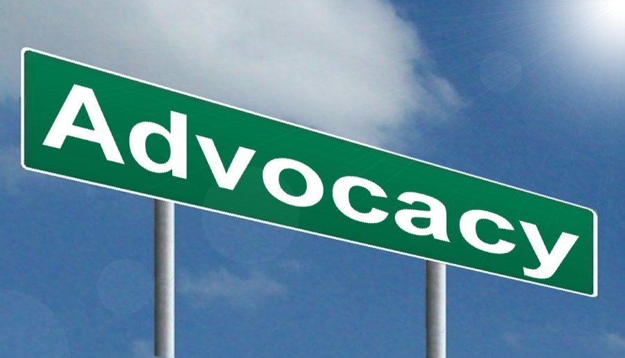 Street sign reading the word Advocacy