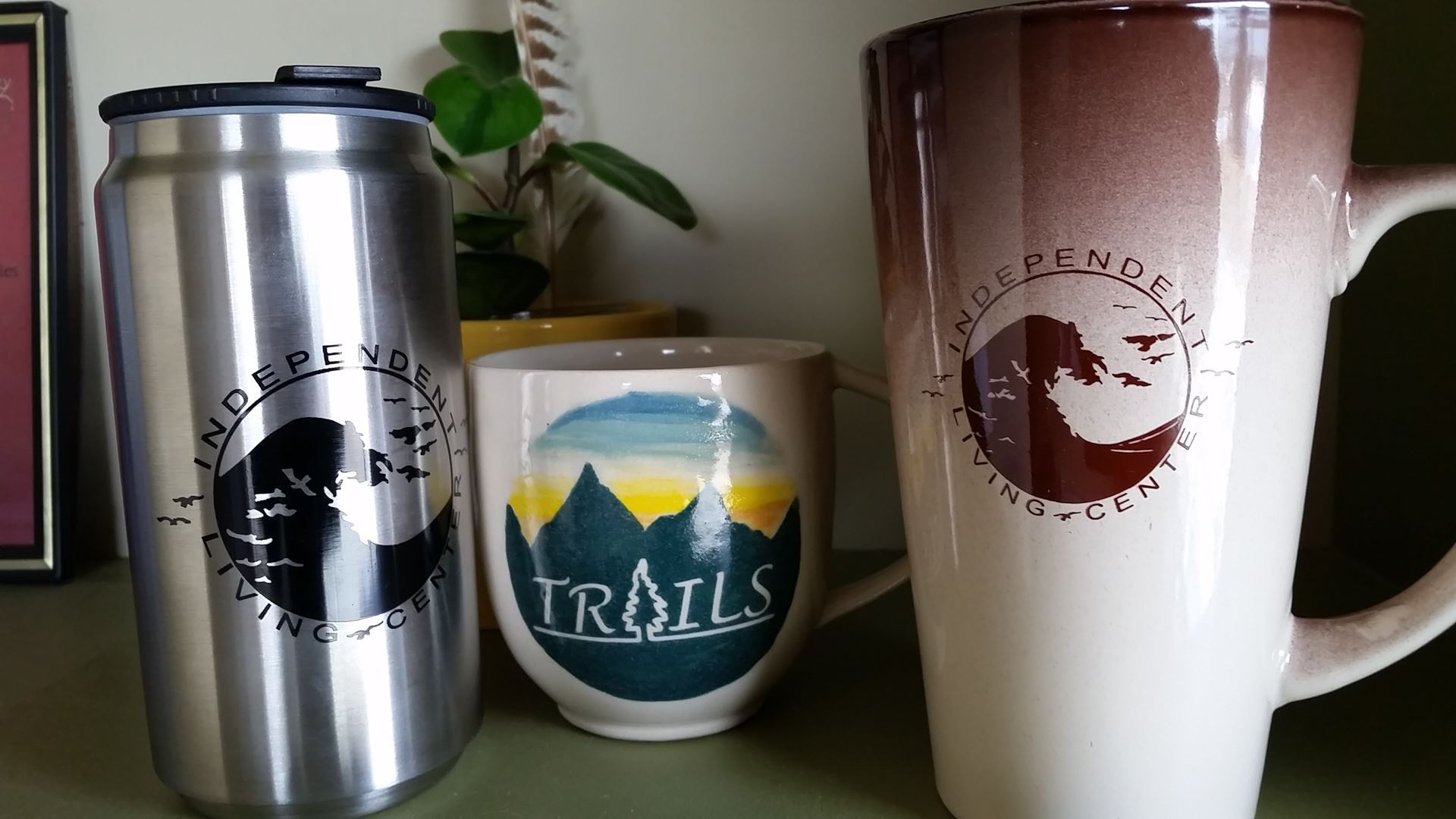 Photo of coffee mugs with ILC and TRAILS logos
